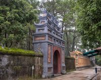 An exit from Tu Duc Royal Tomb complex viewed from the inside stock photo