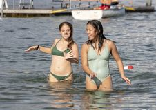 Teenage girls having fun on vacation in the lake at Greenlake Park, Seattle, Washington stock photography