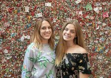 Mother and her teenage girl in front of The Market Theater Gum Wall, Pike Place Market, Seattle, Washington stock photography