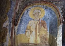 Fresco Saint Stephen, La Chiesa di San Lorenzo, Parco Rupestre Lama D`Antico. Pictured is a fresco showing Saint Stephen in the ancient cave church, La Chiesa di Stock Images