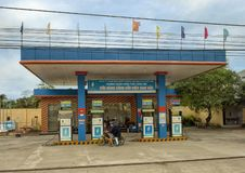 Gas Station in Vietnam, flying the flag of vietnam. Pictured is a gas station in Vietnam with the flag of Vietnam flying from the rooftop in the center of other stock photos