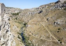 The Gravina di Matera, a river carving the ravine on which Matera was built. Pictured is the Gravina di Matera, a river carving the ravine on which the city of Royalty Free Stock Photography