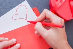 Pictured heart on paper sheet sticking out of envelope Royalty Free Stock Photo