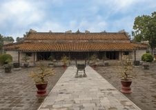 Hoa Kheim Palace, Tu Duc Royal Tomb, Hue, Vietnam. Pictured is the Hoa Khiem Palace in the Tu Duc Royal Tomb complex 4 miles outside of Hue, Vietnam. The palace royalty free stock images