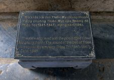 Information plaque for stele in a small pavilion beside the seven story Phuoc Duyen tower in the Thien Mu Pagoda, Hue, Vietnam. Pictured is the information stock photography