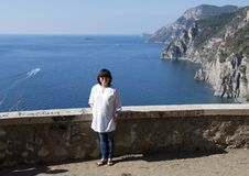Korean woman enjoying vacation scenery along the Amalfi Coast, Italy. Pictured is a Korean woman enjoying the vacation scenery along the Amalfi Coast, a 50 stock photography