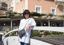 Korean woman on holiday in Positano, a village and comune on the Amalfi Coast, in Campania, Italy. Pictured is a Korean woman on holiday in Positano, a village Stock Photo
