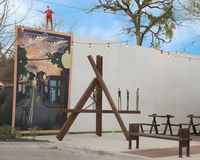 Mural and sculpture, Bishop Arts District, Dallas, Texas. Pictured is a mural by artist Derek Nemunaitis and a sculpture in the Bishop Arts District, Dallas royalty free stock image