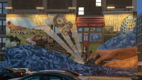 `How We Fish` by Social Impact Studios and ERic Okdeh, Philadelphia, Pennsylvania. Pictured is the mural `How We Fish` by Social Impact Studios and Eric Okdeh royalty free stock photography