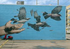 Mural by James Bullough Trinity Groves, Dallas, Texas. Pictured is a mural by James Bullough on the West side of Trinity Groves, Dallas. James Bullough is an royalty free stock photo