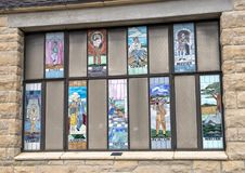 Stained Glass windows honoring Will Rogers, Claremore, Oklahoma. Pictured are nine stained glass windows honoring the many areas of expertise of Will Rogers Royalty Free Stock Photography