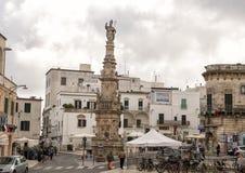 Obelisk of Sant`Oronzo, Ostuni, Italy. Pictured is the Obelisk of Sant`Oronzo in the center of Ostuni, Italy.  The obelisk of Ostuni is dedicated to the patron Stock Image
