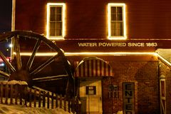 Michigan Cider Mill in Winter. Pictured is an old Michigan Cider Mill. This is a night time shot in the winter royalty free stock photography