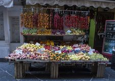 An small outdoor store with fruits and vegetables on a narrow street in Sorrento, Italy. Pictured is an outdoor store with fruits and vegetables on a narrow Stock Images