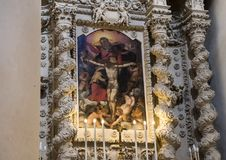 Painting of Jesus above one of the altars, Basilica di Santa Croce. Pictured is a painting of Jesus in crucified position above and altar in the Basilica di Stock Images