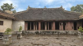 The palace complex adjoining Hoa Khiem Palace in the Tu Duc Royal Tomb complex, Hue, Vietnamn. Pictured is the palace complex adjoining Hoa Khiem Palace in the stock image