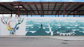 Buck and bear mural Bishop Arts District, Dallas, Texas. Pictured is part of a long wall mural by artist Derek Nemunaitis in the Bishop Arts District, Dallas stock image