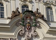 Coat of Arms, Archbishop Palace on Hradcanske Square, Prague. Pictured is the personal coat of arms of Archbishop Prichovsky, the work of Ignac Frantisek Platzer royalty free stock images