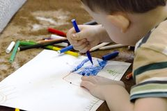 Boy, drawing a picture for fathers day stock image