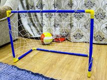Football gate children toy that stand in the room royalty free stock image