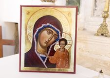 Framed picture Madonna with Child, Church of San Nicola of Myra, Locrotondo, Italy. Pictured is a picture of the Madonna and Child on the altar of the Church of Stock Photos