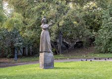 Public Park stone statue of girl with a pigeon, Prague, Czech Republic royalty free stock photos