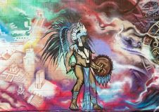 Portion of a large wall mural by Josh Mittag in Dallas, Texas. Pictured is a portion of a large wall mural along a parking lot in Dallas, Texas.  It was painted Stock Photos