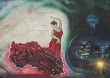 Portion of a large wall mural by Josh Mittag in Dallas, Texas. Pictured is a portion of a large wall mural along a parking lot in Dallas, Texas.  It was painted Stock Photo