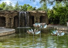 Lay Family Garden at the Dallas Arboretum. Pictured is a portion of the Lay Family Garden in the Dallas Arboretum. In the backgound a 12-foot waterfall cascades royalty free stock image