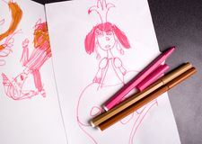 Pictured princess. Childish drawing and some markers laying down the table Royalty Free Stock Photo