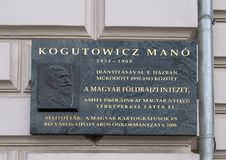 A relief and informational plaque honoring Kogutowicz Mano, a famous Hungarian cartographer royalty free stock image