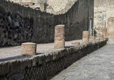Remains of a street in Herculaneum Parco Archeologico di Ercolano. Pictured are remains of a street in Herculaneum in the Parco Archeologico di Ercolano. The Stock Photo