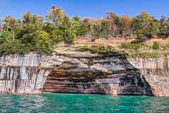 Pictured Rocks Alcove. A large rock alcove adorns the cliffs at Pictured Rocks National Lakeshore on the Upper Peninsula Michigan Coast of Lake Superior stock image