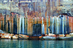 Pictured Rocks National Lakeshore colors. Mineral seepage on a sandstone cliff at Pictured Rocks National Lakeshore creates beautiful colors stock image