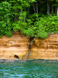 Pictured Rocks National Lakeshore Michigan. Small waterfall flows into Lake Superior at Pictured Rock National Lakeshore in Michigan Royalty Free Stock Photos