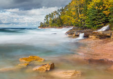 Pictured Rocks Surf. Photographed with a long exposure, waves crash on the rocky coast of Miner's Beach at Upper Peninsula Michigan's Pictured Rocks National stock images