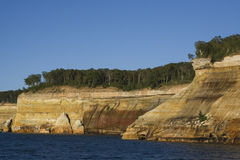 Pictured-rocks. Trees and water at Lake Superior upper-peninsula  Michigan. Sandstone mineral colors blue-sky cliff Royalty Free Stock Photos