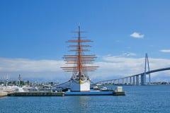 Sailing ship named Kaiomaru and bridge. Pictured sailing ship named Kaiomaru and bridge in Japan Royalty Free Stock Photos