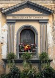 An small shrine to Maria SS.ma del Carmine on a narrow street in Sorrento, Italy. Pictured is a small shrine to Maria SS.ma del Carmine on a narrow street in Stock Image
