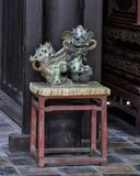 Statue of male Foo Dog inside the Hoa Kheim Palace, Tu Duc Royal Tomb, Hue, Vietnam. Pictured is a small statue of a male Foo Dog inside the Hoa Kheim Palace in royalty free stock photo