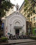 Old church now a book publishing company in Hanoi, Vietnam royalty free stock images