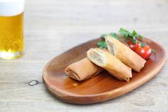 Spring roll on a wooden plate Stock Image