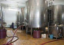 Stainless steel wine fermentation tanks, Tomaresca Tenuta Bocca di Lupo. Pictured are the stainless steel wine fermentation tanks of the Tomaresca Tenuta Bocca Royalty Free Stock Photo