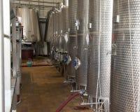 Stainless steel wine fermentation tanks, Tomaresca Tenuta Bocca di Lupo. Pictured are the stainless steel wine fermentation tanks of the Tomaresca Tenuta Bocca Stock Photo