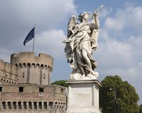 Marble Angel holding the Lance of Longinis on the Ponte Sant`Angelo. Pictured is a statue of a Marble Angel holding the Lance of Longinis with the inscription Royalty Free Stock Photography