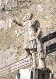 Statue of Marco Nonio Balbo on the Marco Nonio Balbo terrace in Parco Archeologico di Ercolano. Pictured is a statue of Marco Nonio Balbo and two Angel figures Royalty Free Stock Photography