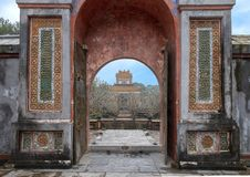 The Stele Pavilion from inside the sepulcher in Tu Duc Royal Tomb, Hue, Vietnam. Pictured is the Stele Pavilion framed by a doorway. It is viewed from inside the stock photos