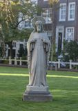 Stone Statue of Sacred Heart of Jesus Christ, Amsterdam Begijnhof royalty free stock images