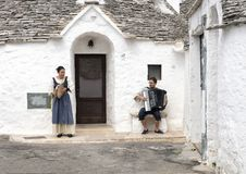 Street Performers in front of the Trulli Holiday Resort, Alberobello, Italy Stock Image