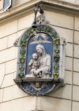 Street light with carved relief of Madonna and Child on building corner, Rome Italy. Pictured is a streetlight with a carved relief of Madonna and Child on a Royalty Free Stock Images
